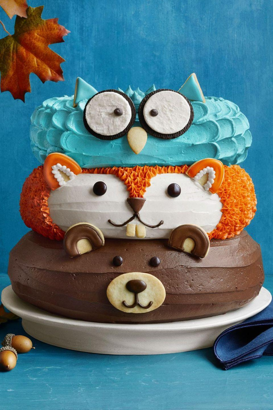 """<p>This might look complicated, but it's really not. After making three cakes, use buttercream to frost and candy and cookies to create their little faces. Too much? Try your hand at just one of these forest friends.</p><p><strong><em><a href=""""https://www.womansday.com/food-recipes/food-drinks/a24216714/forest-friends-cake-recipe/"""" rel=""""nofollow noopener"""" target=""""_blank"""" data-ylk=""""slk:Get the Forest Friends Cake recipe."""" class=""""link rapid-noclick-resp""""> Get the Forest Friends Cake recipe. </a></em></strong></p>"""
