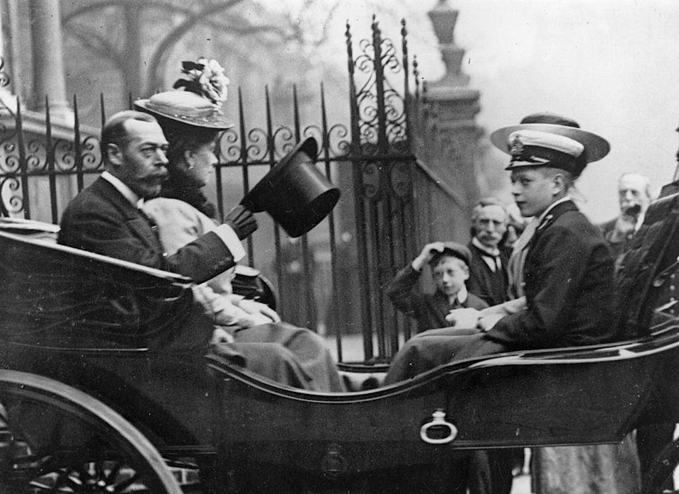 <p>King George V, Queen Mary, and their youngest son Prince John leave the Great Allied War Photographic Exhibition. </p>