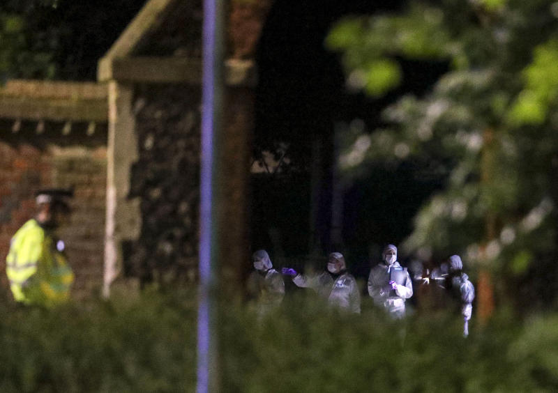 Forensic officers work at Forbury Gardens park in Reading, England, early Sunday June 21, 2020, after a summer-evening stabbing attack took place at the park Saturday. (Steve Parsons/PA via AP)