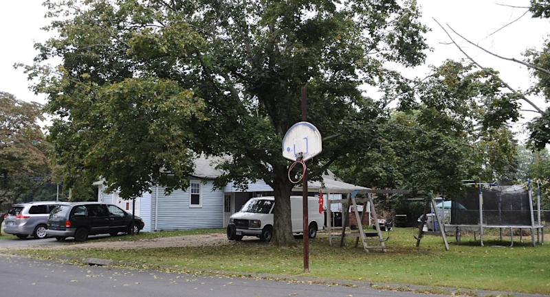 A house owned by the uncle of former New England Patriot's Aaron Hernandez, is seen,Thursday, Sept. 12, 2013 in Bristol, Conn. A group of people who all have ties to a small blue cape-style home in Bristol have become central figures in the investigations linking former New England Patriot Aaron Hernandez to two murder cases. (AP Photo/Jessica Hill)