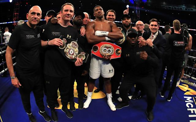 <span>Joshua and team post-fight</span> <span>Credit: GETTY IMAGES </span>