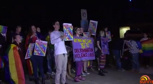 Angry rival protesters clashed outside a Brisbane church, resulting in one woman being arrested. Photo: 7 News