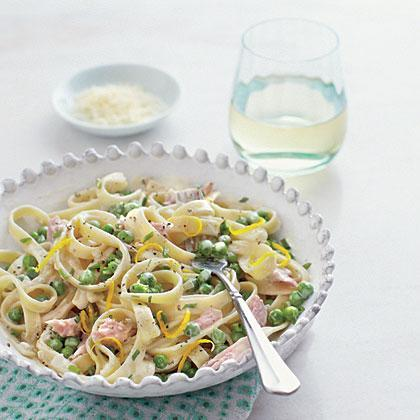 """<p>Add color and nutrients to this <a href=""""https://www.myrecipes.com/pasta-recipes"""" rel=""""nofollow noopener"""" target=""""_blank"""" data-ylk=""""slk:quick and easy pasta dish"""" class=""""link rapid-noclick-resp"""">quick and easy pasta dish</a> by adding fresh peas to the sauce. Chopped ham pairs perfectly with the peas and lends extra protein and salty flavors to the pasta, making it a satisfying and filling meal. </p>"""