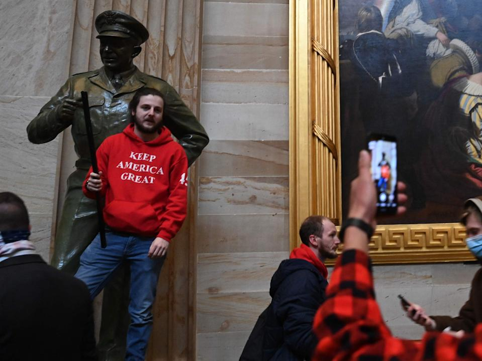 <p>Supporters of US President Donald Trump enter the US Capitol's Rotunda on 6 January 6, 2021 in Washington, DC</p> ((AFP via Getty Images))
