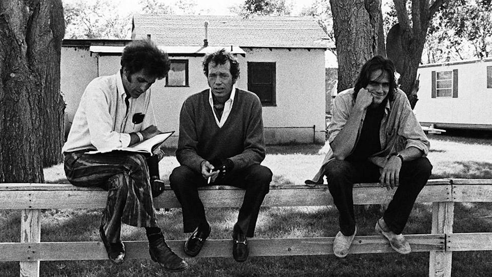 """Director Monte Hellman, left, with Warren Oates and James Taylor, on set for """"Two-Lane Blacktop"""" in 1971 - Credit: Courtesy Everett Collection"""