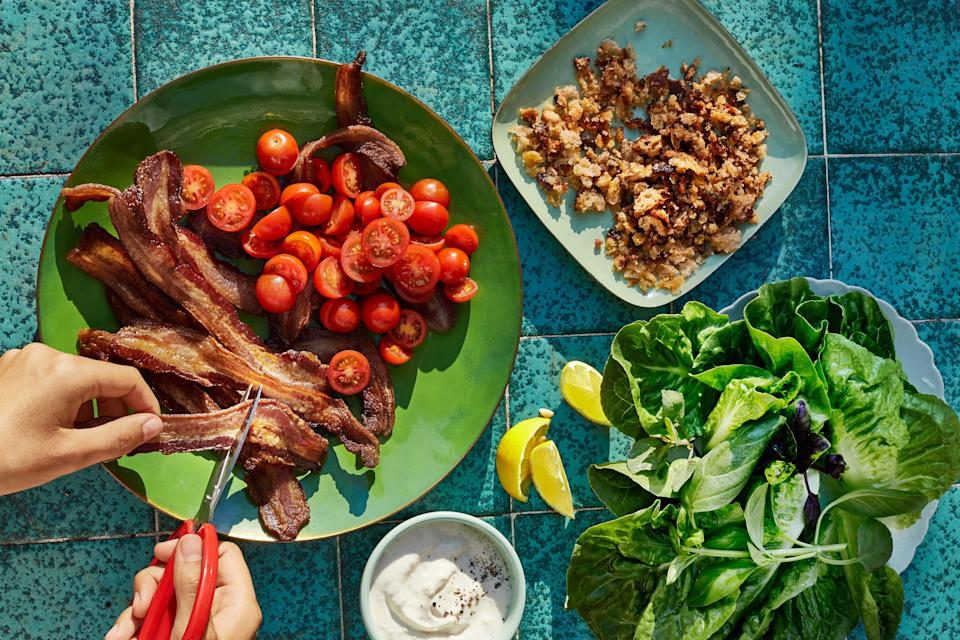 """Flip the script on BLTs (but don't lose any of the bacon) by toasting breadcrumbs (enriched with bacon fat) and piling it with tomatoes, horseradish mayo, and bacon strips into lettuce wraps. <a href=""""https://www.epicurious.com/recipes/food/views/blt-wraps-with-horseradish-mayonnaise?mbid=synd_yahoo_rss"""" rel=""""nofollow noopener"""" target=""""_blank"""" data-ylk=""""slk:See recipe."""" class=""""link rapid-noclick-resp"""">See recipe.</a>"""