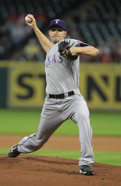 Texas Ranger's Scott Baker delivers a pitch against the Houston Astros in the first inning of a baseball game Friday, Aug. 29, 2014, in Houston. (AP Photo/Richard Carson)