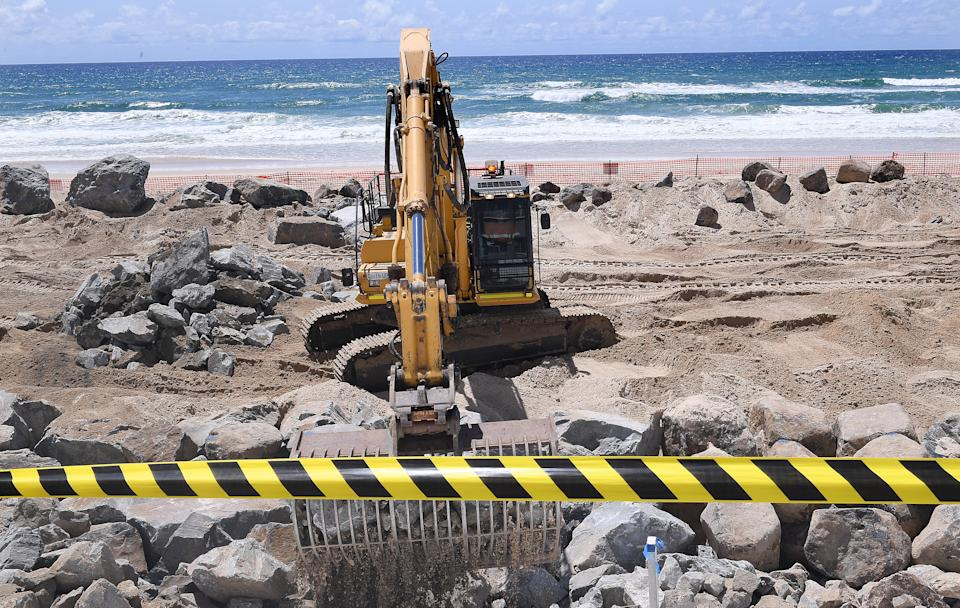 Seawall construction is seen on the Gold Coast before huge swells and high tides pummel southeast Queensland beaches. Source: AAP