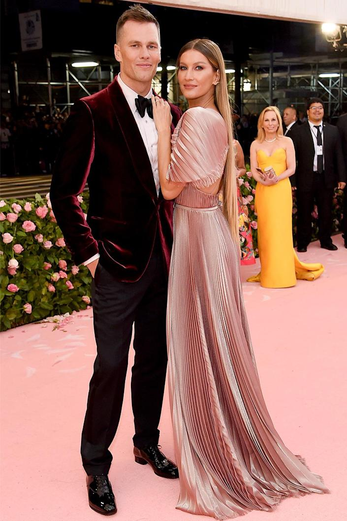 """<p>Some say the Met Gala is the Super Bowl of fashion, but the Tampa Bay Buccaneers quarterback seemed to have his eyes on the NFL championship in an <a href=""""https://www.instagram.com/p/CTxjYj0AyuZ/"""" rel=""""nofollow noopener"""" target=""""_blank"""" data-ylk=""""slk:Instagram"""" class=""""link rapid-noclick-resp"""">Instagram</a> address to fans on Met Monday this year.</p> <p>""""Football is officially back, and it's great to be 1-0,"""" Brady said, referencing the Buccs' victory over the <a href=""""https://people.com/sports/how-to-watch-first-game-nfl-2021-season-buccaneers-cowboys/"""" rel=""""nofollow noopener"""" target=""""_blank"""" data-ylk=""""slk:Dallas Cowboys"""" class=""""link rapid-noclick-resp"""">Dallas Cowboys</a> last week. """"We've got a big week ahead, the marathon's just getting started. We got a lot to improve on, and excited for this week.""""</p>"""