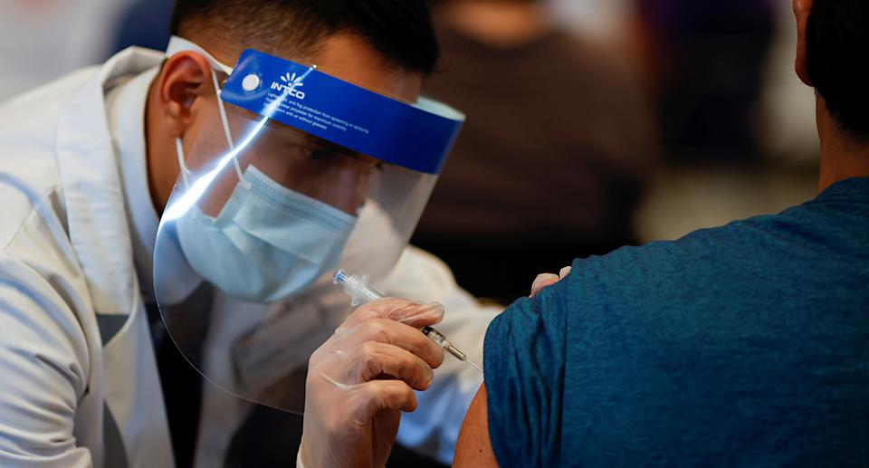 A person receives a dose of the COVID-19 vaccine in Chicago, Illinois, USA. Photo: Reuters