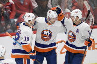 New York Islanders defenseman Devon Toews (25) celebrates his goal with left wing Anthony Beauvillier (18) and right wing Josh Bailey (12) during the first period of an NHL hockey game against the Washington Capitals, Monday, Feb. 10, 2020, in Washington. (AP Photo/Nick Wass)