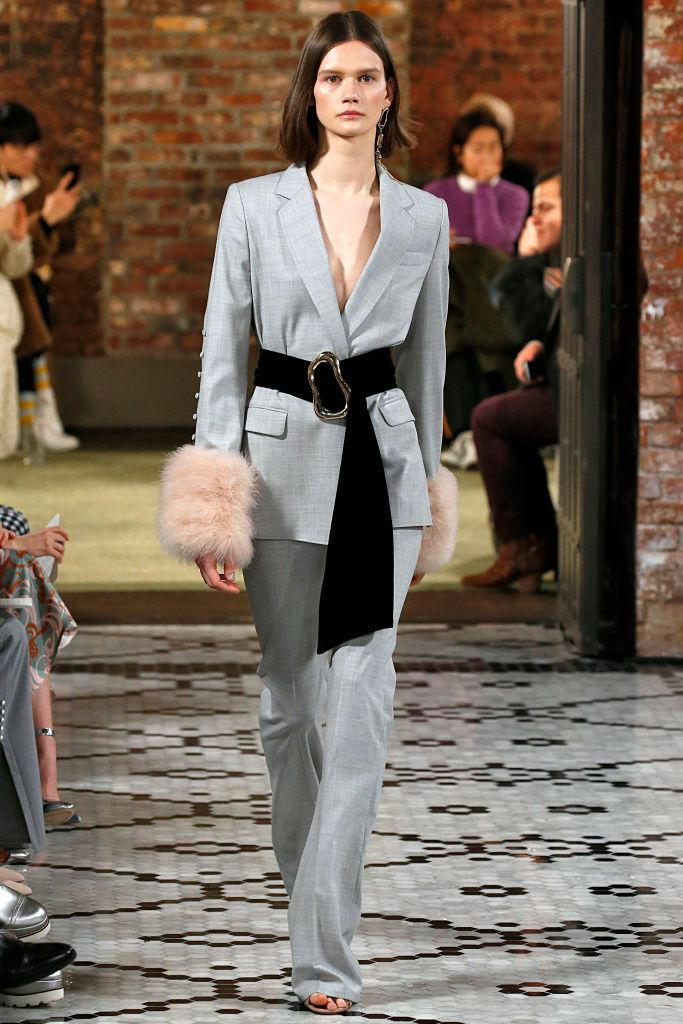 <p>Model wears a gray pantsuit and waist belt at the fall 2018 Adeam show. (Photo: Getty Images) </p>