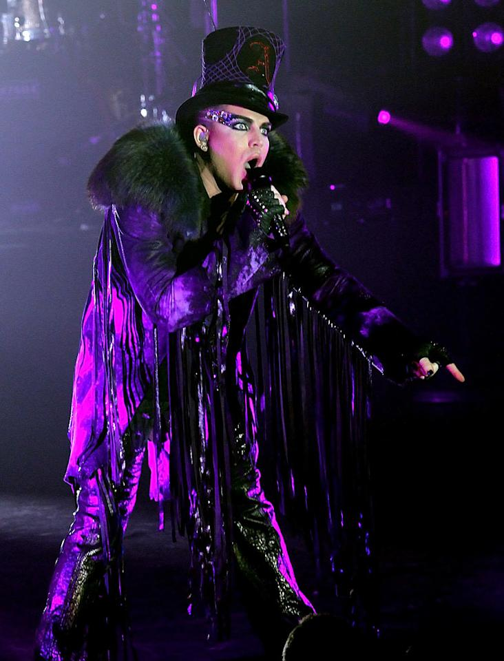 "Not to be outdone in the awful ensemble department was former ""Idol"" contestant Adam Lambert, who treated his fans to this goth getup, which featured a faux fur and pleather fringe-adorned coat, during a concert stop in NYC. <a href=""http://www.splashnewsonline.com"" target=""new"">Splash News</a> - June 22, 2010"