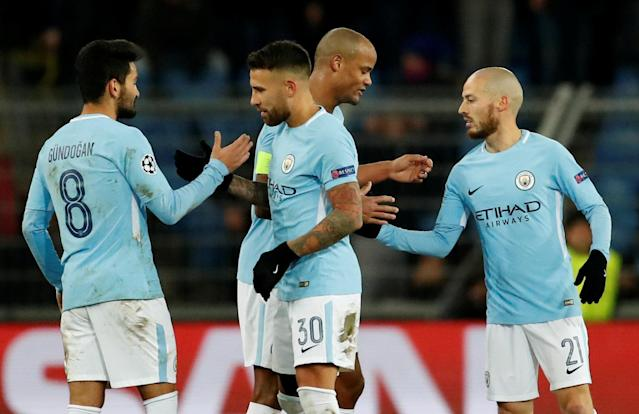 Soccer Football - Champions League - Basel vs Manchester City - St. Jakob-Park, Basel, Switzerland - February 13, 2018 Manchester City's Nicolas Otamendi and team mates celebrate after the match Action Images via Reuters/Andrew Boyers
