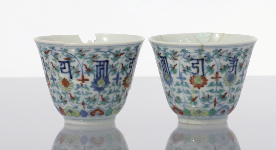 Two antique cups that were nearly thrown away sold at an auction for over £11,000 (SWNS)