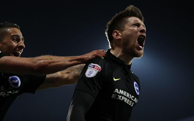 Brighton's Sebastien Pocognoli celebrates scoring at Loftus Road  - Rex Features