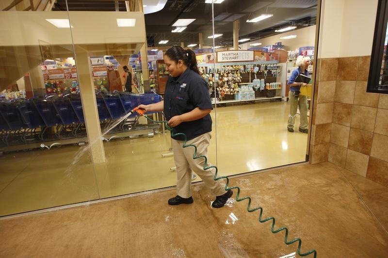 Vanessa Espinosa sanitizes a dog play room at a PetSmart PetsHotel and Doggie Day Camp in Los Angeles