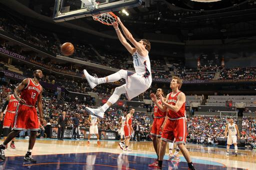 CHARLOTTE, NC - APRIL 13: Josh McRoberts #11 of the Charlotte Bobcats dunks against the Milwaukee Bucks at the Time Warner Cable Arena on April 13, 2013 in Charlotte, North Carolina. (Photo by Kent Smith/NBAE via Getty Images)