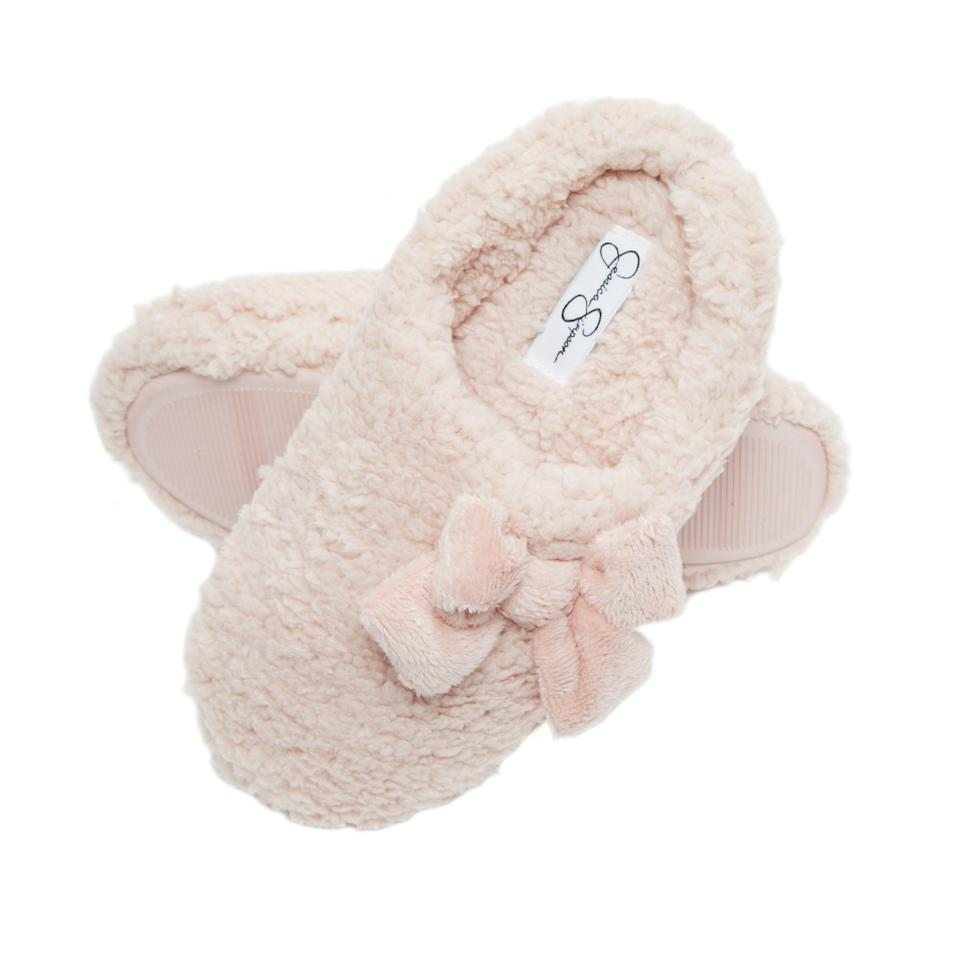 """It's pretty much time to start decking the halls and singing Christmas carols…and wear soft, fuzzy slippers while doing so. That where's Jessica Simpson's Plush Marshmallow House Slippers come in. They're made with thick, high-density memory foam for extra comfort, an anti-slip sole, and come in 11 colors and four sizes. Your lucky, everything-cozy-loving recipient will live in these until spring rolls around again, and perhaps even then, too.<br> <br> <strong>$17</strong> (<a href=""""https://www.amazon.com/Jessica-Simpson-Womens-Marshmallow-Slipper/dp/B088XBX8XM"""" rel=""""nofollow noopener"""" target=""""_blank"""" data-ylk=""""slk:Shop Now"""" class=""""link rapid-noclick-resp"""">Shop Now</a>)"""