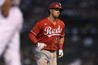 Cincinnati Reds' Kyle Farmer rounds the bases after hitting a solo home run during the fourth inning of a baseball game against the Chicago Cubs, Monday, July 26, 2021, in Chicago. (AP Photo/Paul Beaty)
