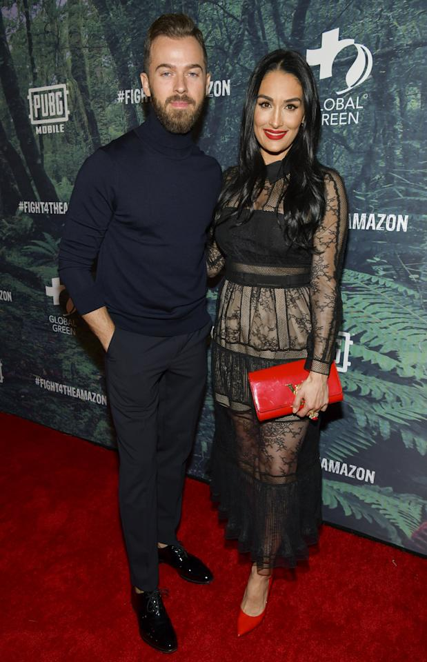 """<p>In January, the former wrestler announced that she's expecting her first child <a href=""""https://www.popsugar.com/celebrity/Nikki-Bella-Artem-Chigvintsev-Dating-45955263"""" class=""""ga-track"""" data-ga-category=""""Related"""" data-ga-label=""""https://www.popsugar.com/celebrity/Nikki-Bella-Artem-Chigvintsev-Dating-45955263"""" data-ga-action=""""In-Line Links"""">with fiancé Artem Chigvintsev</a>. Her due date is only a week and a half apart from her twin sister, Brie. </p>"""