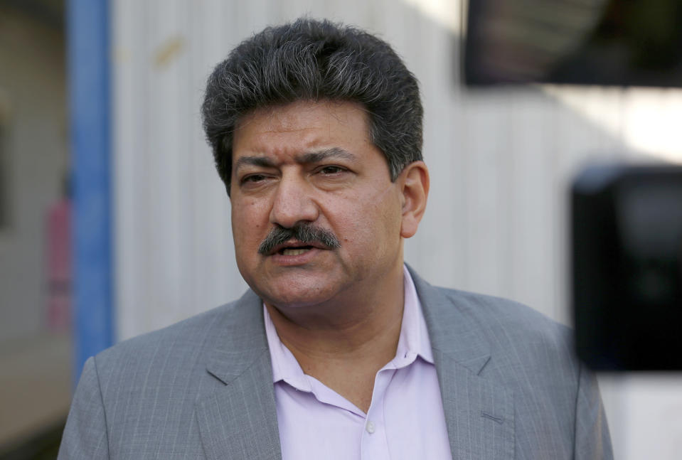 Pakistani journalist Hamid Mir speaks during an interview with The Associated Press, in Islamabad, Pakistan, Tuesday, June 1, 2021. Mir was taken off air as the host of his popular talk show by Pakistan's Geo News TV because of an anti-army speech at a rally Friday. (AP Photo/Anjum Naveed)