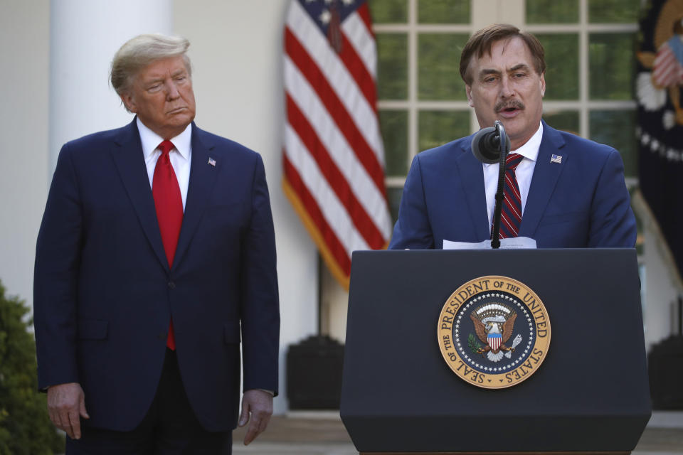 FILE - In this March 30, 2020 file photo, My Pillow CEO Mike Lindell speaks as President Donald Trump listens during a briefing about the coronavirus in the Rose Garden of the White House, in Washington. Lindell, is weighing a run for governor in Minnesota. If he follows through on a campaign, it could be an early test of where the Republican Party is headed in the post-Donald Trump era. (AP Photo/Alex Brandon, File)