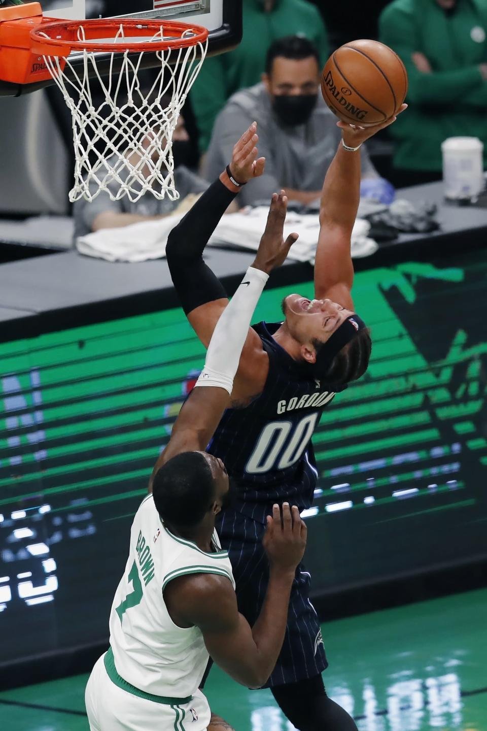 Orlando Magic's Aaron Gordon (00) shoots against Boston Celtics' Jaylen Brown (7) during the first half of an NBA basketball game, Sunday, March 21, 2021, in Boston. (AP Photo/Michael Dwyer)
