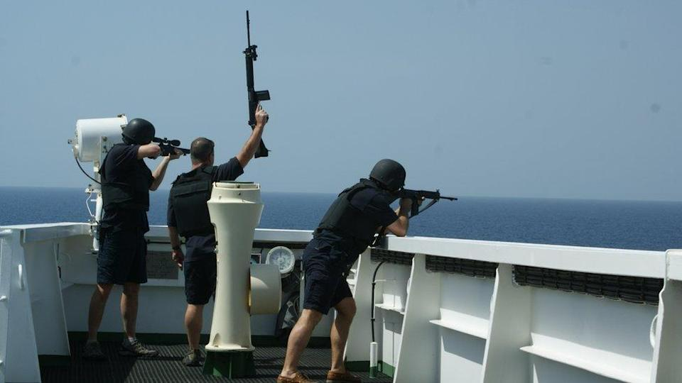 """British maritime security guards """"showing weapons"""" to ward off pirates from the bridge of a merchant tanker on an earlier voyage. It is understood there were armed guards on board the MT Mercer Street when it was attacked"""