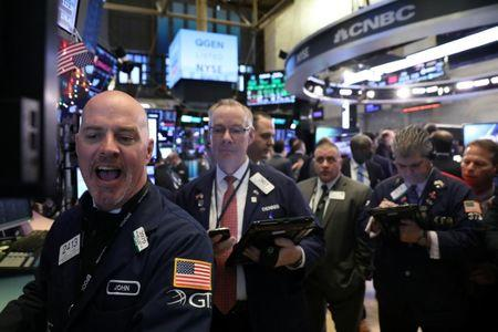 Wall Street rallies as Fed sees interest rate 'just below' neutral