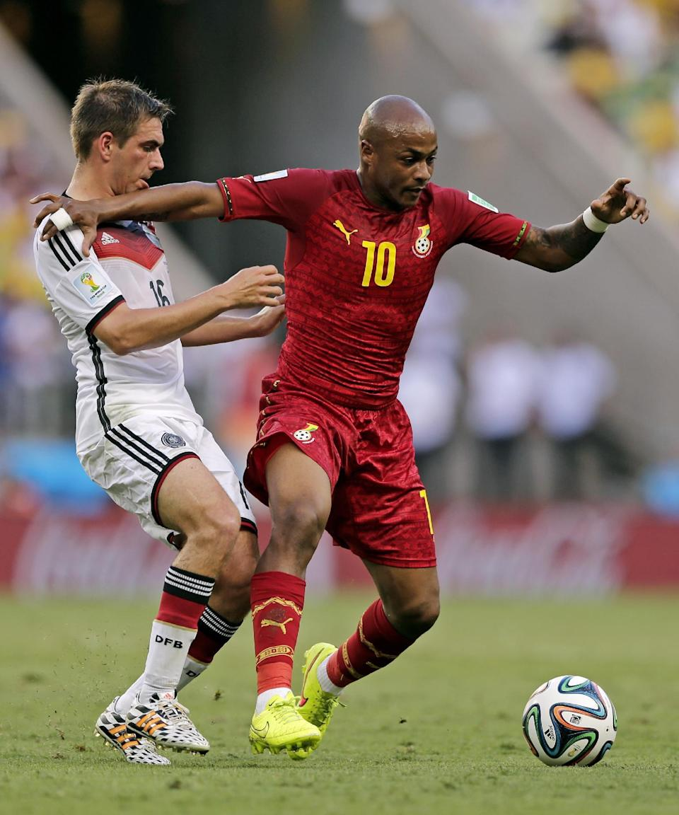 Ghana's Andre Ayew holds off Germany's Philipp Lahm, left, during the group G World Cup soccer match between Germany and Ghana at the Arena Castelao in Fortaleza, Brazil, Saturday, June 21, 2014. (AP Photo/Matthias Schrader)