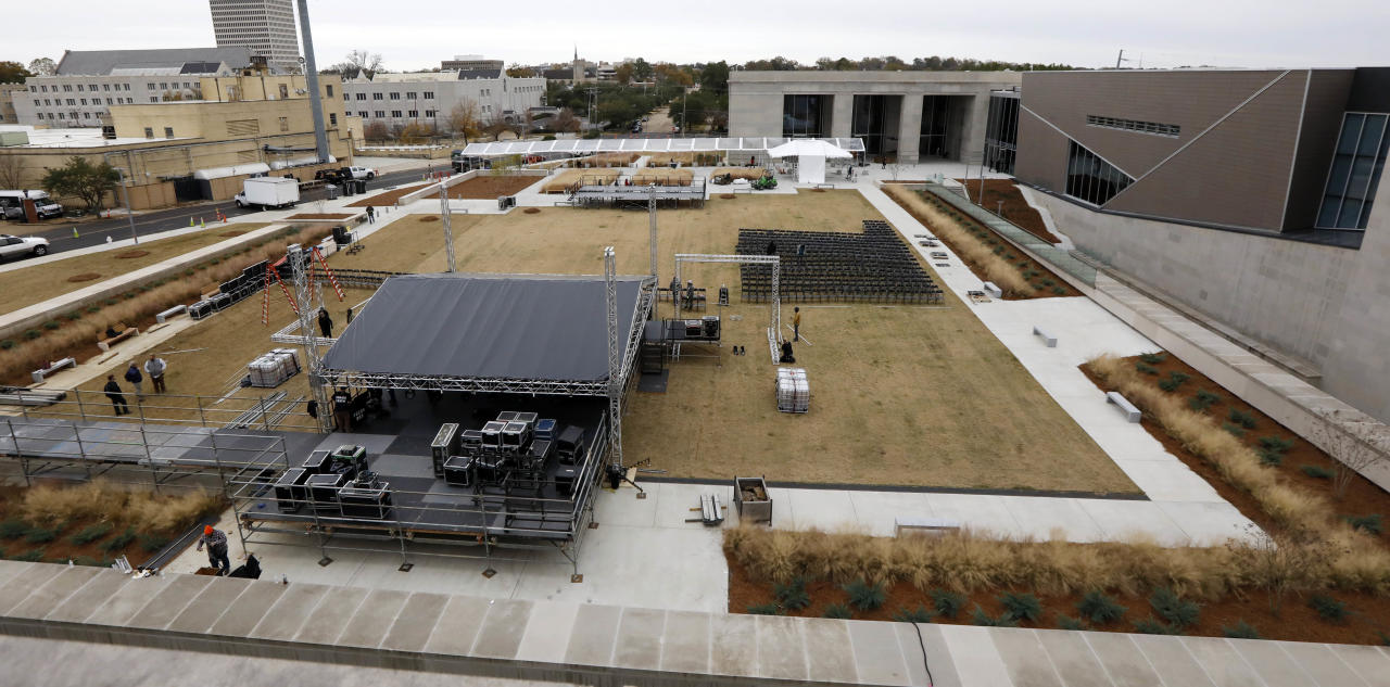 <p>Work crews rush to set up a stage beside the state's two newest museums, the Museum of Mississippi History and the Mississippi Civil Rights Museum, Thursday, Dec. 7, 2017 in Jackson, Miss. (Photo: Rogelio V. Solis/AP) </p>