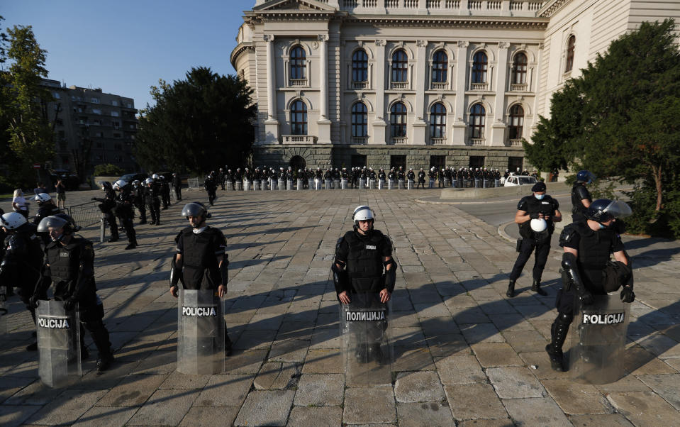 Riot police guards the area in front of the Serbian Parliament building as people gather for a demonstration in Belgrade, Serbia, Wednesday, July 8, 2020. Serbia's president Aleksandar Vucic backtracked Wednesday on his plans to reinstate a coronavirus lockdown in Belgrade after thousands protested the move and violently clashed with the police in the capital. (AP Photo/Darko Vojinovic)