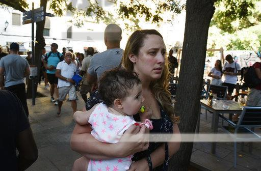 <p>People flee the scene in Barcelona, Spain, Thursday, Aug. 17, 2017 after a white van jumped the sidewalk in the historic Las Ramblas district, crashing into a summer crowd of residents and tourists and injuring several people, police said. (Giannis Papanikos/AP) </p>