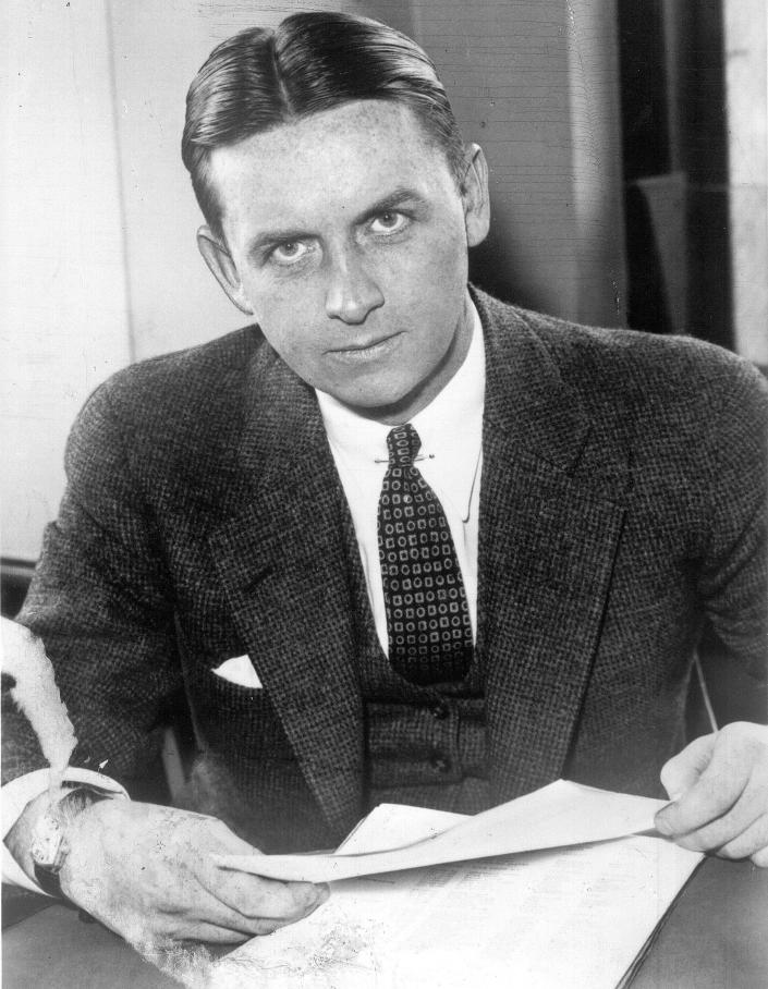 FILE - This undated file photo shows Eliot Ness in Cleveland. Portrayed over the years by Kevin Costner and Robert Stack as an incorruptible hero, Ness' legend is now at risk, with some claiming his role in taking out Chicago mobster Al Capone is as mythical as Mrs. O'Leary's cow starting the Great Chicago Fire. Illinois' two U.S. senators, Democrat Dick Durbin and Republican Mark Kirk, have proposed naming the Bureau of Alcohol, Tobacco, Firearms and Explosives headquarters in Washington after the Prohibition-era crime fighter, but Ed Burke, a prominent Chicago alderman and others are trying to convince the senators to drop the whole thing. Both senators are not backing down, though, insisting he deserves it anyway. (AP Photo/The Plain Dealer, File)