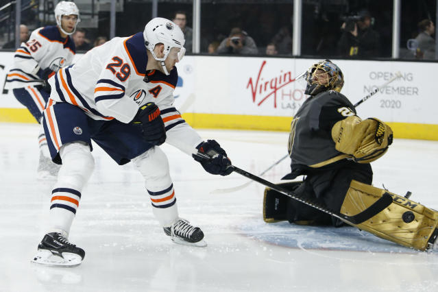 Edmonton Oilers center Leon Draisaitl (29) takes a shot on Vegas Golden Knights goaltender Marc-Andre Fleury (29) during the first period of an NHL hockey game Wednesday, Feb. 26, 2020, in Las Vegas. (AP Photo/John Locher)