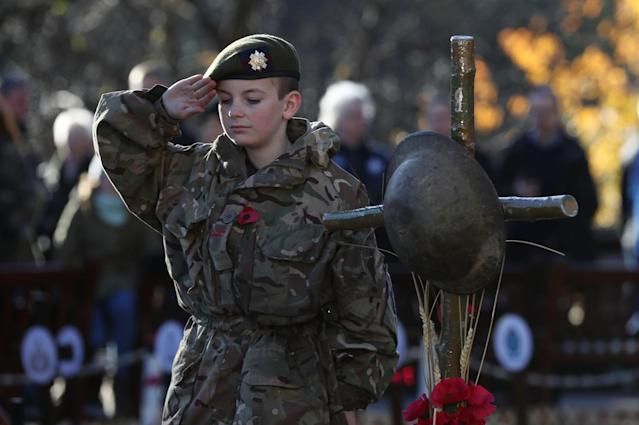 <p>Scots Guards Army Cadet Force member Nathan Skinner, 13, salutes in memory of those who have fallen in conflict, following a service of Remembrance at the Edinburgh Garden of Remembrance in East Princes Street Gardens, Edinburgh. (Photo: Andrew Milligan/PA Images via Getty Images) </p>