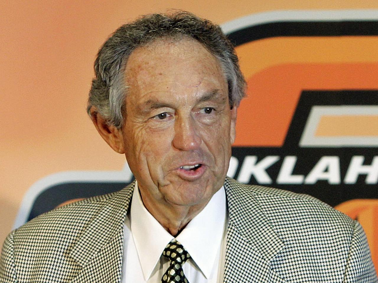 Eddie Sutton, as Oklahoma State University basketball head coach, announcing his retirement, photo on black