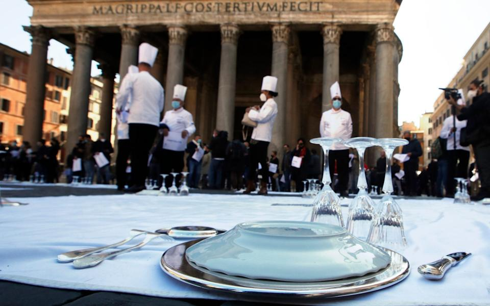 Cooks and restaurant owners protest against the government restriction measures to curb the spread of COVID-19, closing restaurants at night, at Rome's Pantheon Square - AP Photo/Alessandra Tarantino