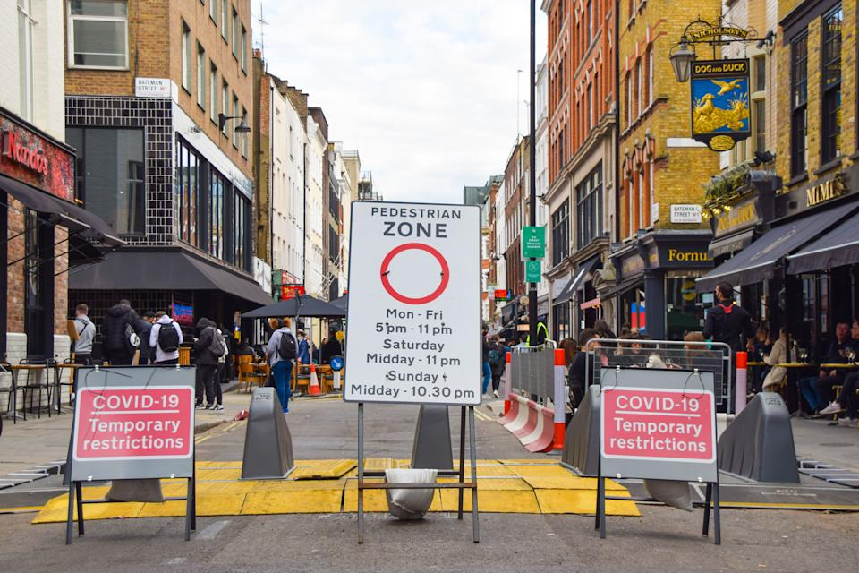 Pedestrian Zone and Covid-19 Temporary Restrictions signs in Frith Street, Soho, Central London. Restaurants, pubs and bars in England have reopened for outdoor service only, and several streets in Soho have been closed to traffic at certain times of the day to allow for street seating. (Photo by Vuk Valcic / SOPA Images/Sipa USA)