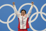 Shi Tingmao of China reacts after winning gold medal in women's diving 3m springboard final at the Tokyo Aquatics Centre at the 2020 Summer Olympics, Sunday, Aug. 1, 2021, in Tokyo, Japan. (AP Photo/Dmitri Lovetsky)