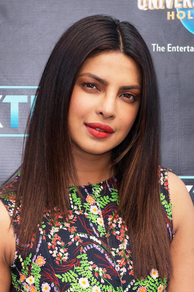 <p>Priyanka's barely-there ombré transitions from her natural brunette to a sun-kissed brown. </p>