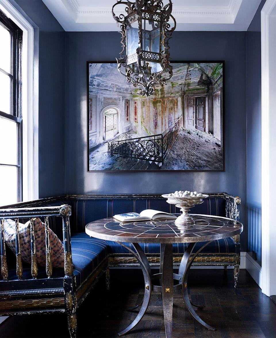 """<p>Though technically not a home office, this moody breakfast nook designed by <a href=""""https://www.housebeautiful.com/design-inspiration/house-tours/a35941060/ray-attanasio-steve-ables-manhattan-apartment/"""" rel=""""nofollow noopener"""" target=""""_blank"""" data-ylk=""""slk:Ray Attanasio"""" class=""""link rapid-noclick-resp"""">Ray Attanasio</a> has everything you need to get the job done, from comfortable seating to plenty of natural light. Plus, the baroque setting makes it feel like an old-timey library. </p>"""