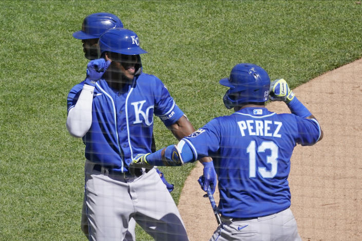Kansas City Royals Salvador Perez, right, and Carlos Santana celebrate a two-run home run by Perez in the third inning of a baseball game Saturday, May 1, 2021, in Minneapolis. (AP Photo/Jim Mone)