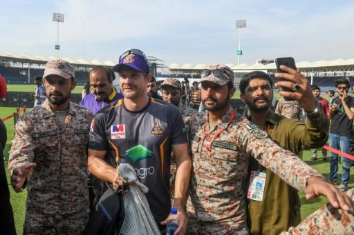 Quetta's Australian star Shane Watson leaves the ground under heavy secuirty after practising in Karachi this week
