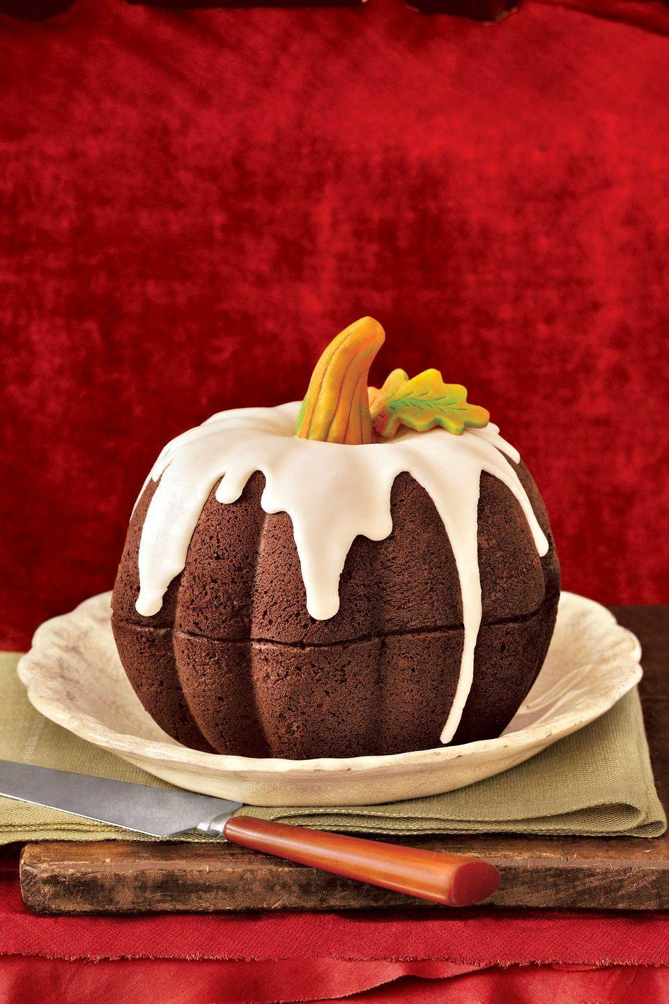 """<p>With its vanilla-sugar icing and marzipan stem, this cake is sure to earn Best in Show. The secret to its perfect form? A fluted, dome-shaped pan. The pumpkin shape is actually two dome cakes, fitted together. Add stem and leaf after icing.</p><p><strong><a href=""""https://www.countryliving.com/food-drinks/g274/pumpkin-cakes/?slide=19"""" rel=""""nofollow noopener"""" target=""""_blank"""" data-ylk=""""slk:Get the recipe"""" class=""""link rapid-noclick-resp"""">Get the recipe</a>.</strong> </p>"""