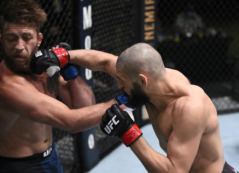 LAS VEGAS, NEVADA - SEPTEMBER 19: (R-L) Khamzat Chimaev of Chechnya punches Gerald Meerschaert in their middleweight bout during the UFC Fight Night event at UFC APEX on September 19, 2020 in Las Vegas, Nevada. (Photo by Chris Unger/Zuffa LLC)