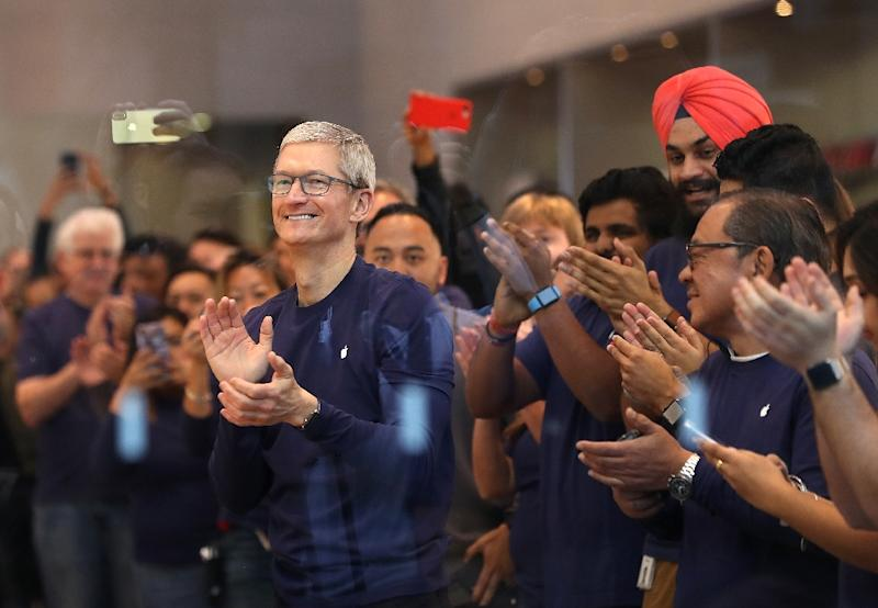 Apple CEO Tim Cook says the iPhone maker's repatriated profits will result in a $38 billion US tax payment and generate $350 billion in economic activity