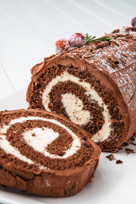 """<p>The Bûche de Noël cake is a French Christmas tradition that dates back to the 19th century. The cake represents the yule log that families would burn starting on Christmas Eve. While no one is positive on exactly how the yule log turned into a cake, everyone can agree it's a delicious tradition we NEVER want to end.</p><p>Get the <a href=""""https://www.delish.com/uk/cooking/recipes/a29681441/buche-de-noel-yule-log-cake-recipe/"""" rel=""""nofollow noopener"""" target=""""_blank"""" data-ylk=""""slk:Bûche de Noël"""" class=""""link rapid-noclick-resp"""">Bûche de Noël</a> recipe.</p>"""