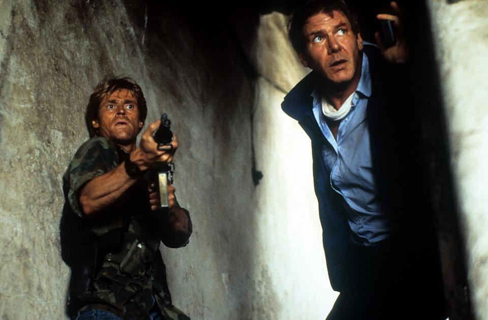 Harrison Ford and Willem Dafoe are ready for attack in a scene from the film 'Clear and Present Danger', 1994. (Photo by Paramount Pictures/Getty Images)
